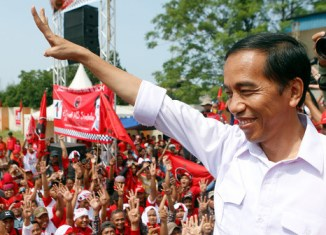 Indonesia's Jokowi sworn in as president as economic problems mount