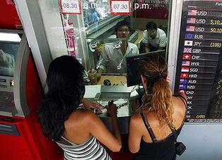 Thai baht falls to record low