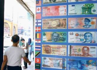 No single currency in sight for ASEAN