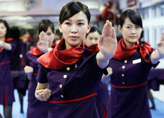 Hong Kong flight attendants learn how to kick butt