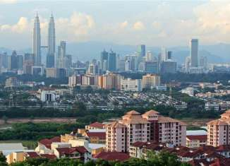 Malaysia limits bulk sales of property to 4 units
