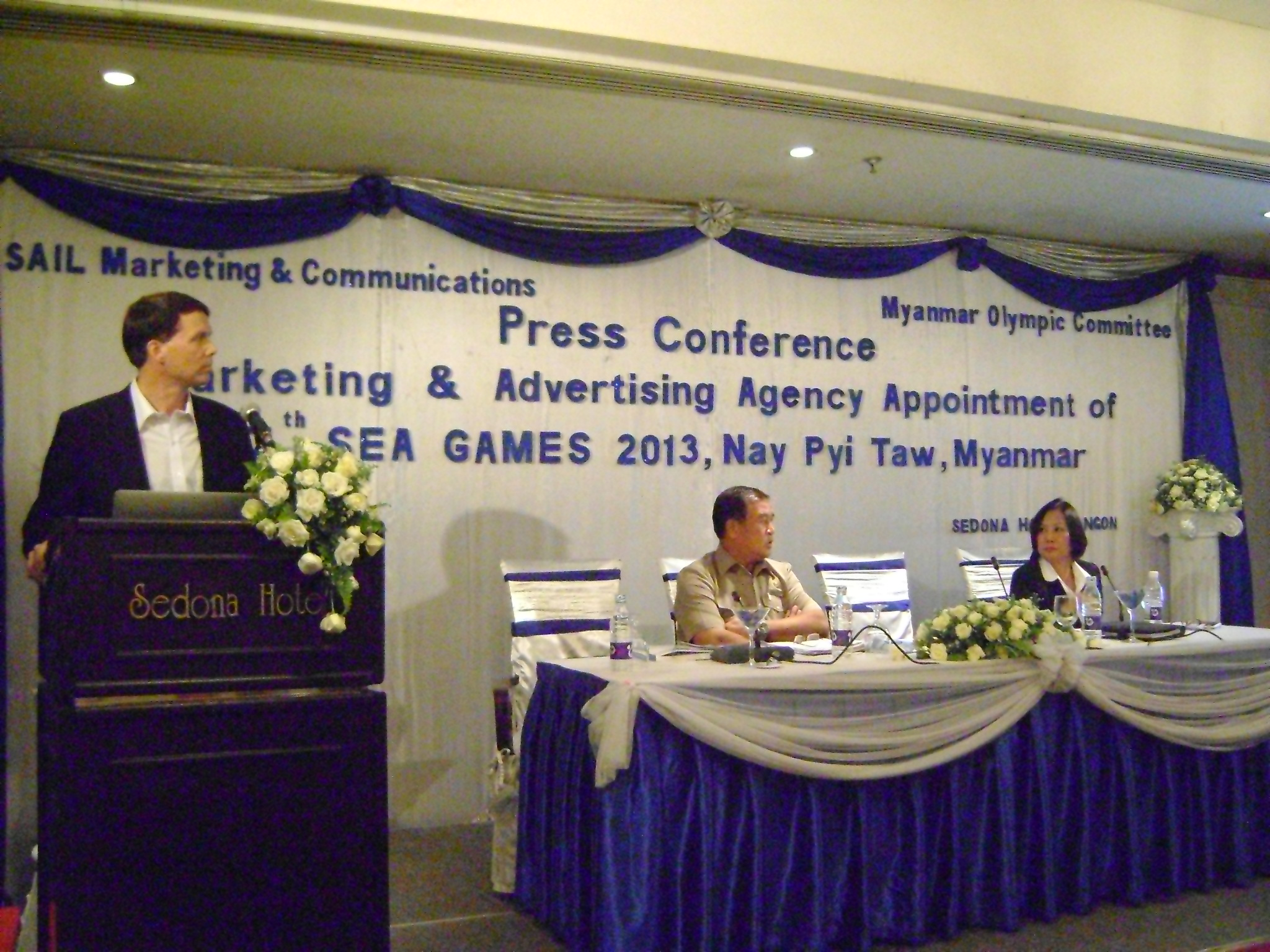 SAIL CEO Mr. John Handley Presents SEA Games Sponsorship Approach With U Thaung Htike Centre And Dr. Khin Khin Kyawt Right Looking On During A July 7th Press Conference In Yangon