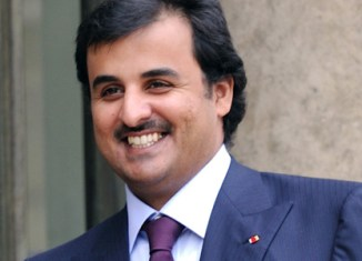 Qatar emir resigns, hands over power to son