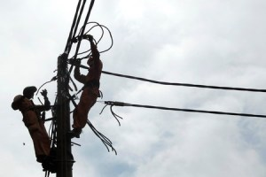Workers repair electric grid in Hanoi