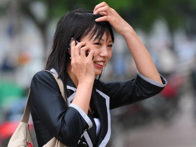 Asian Woman Business Phone