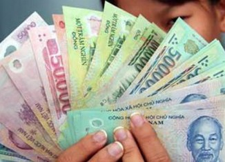 Vietnam cuts dong rate to US dollar by 1%