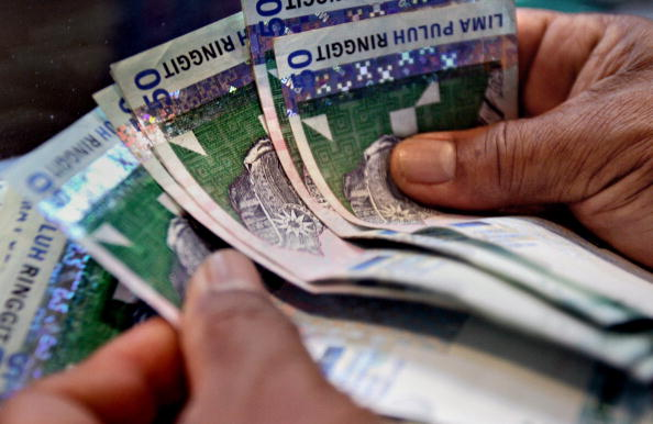 Malaysia tries to curb 'excessive' household lending