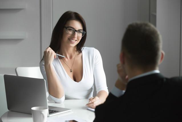 Beautiful businesswoman talking to a male job PYG84WK