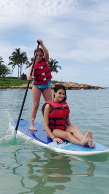 Madi, paddle boarding with sister in Hawaii