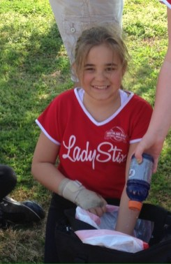 Madi, playing softball