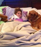 Madi, stuck in bed with dog