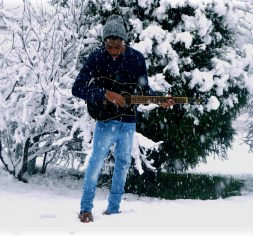 Sellars playing guitar in snow