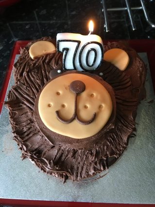 The 70th Birthday Cake I bought my mum; it's a bear's face with lots of thick icing.