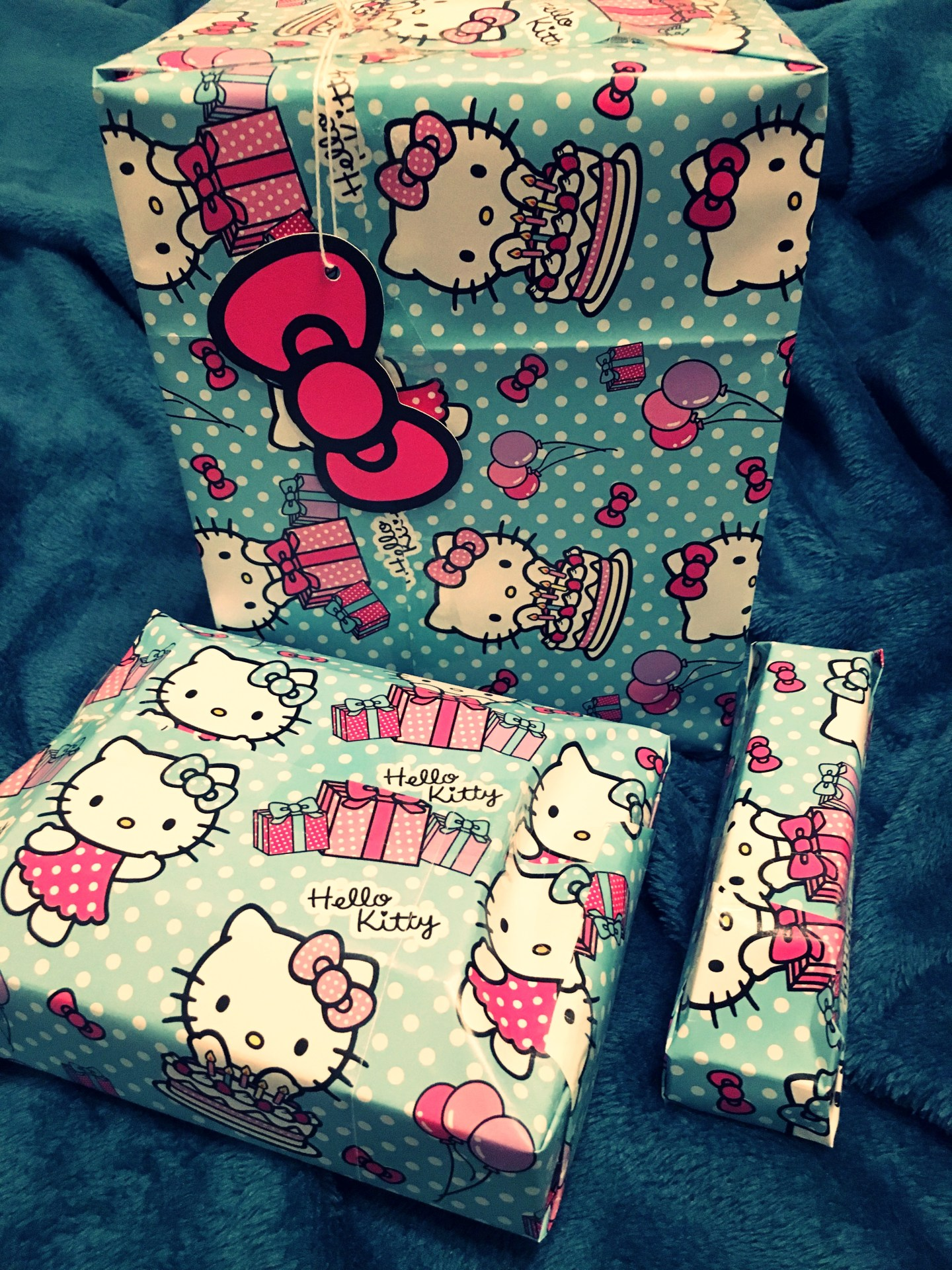 The presents for my mum wrapped in green and pink Hello Kitty wrapping paper.