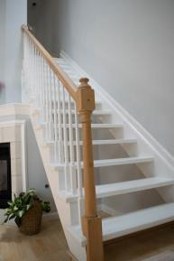 A photo of a white staircase in a house.