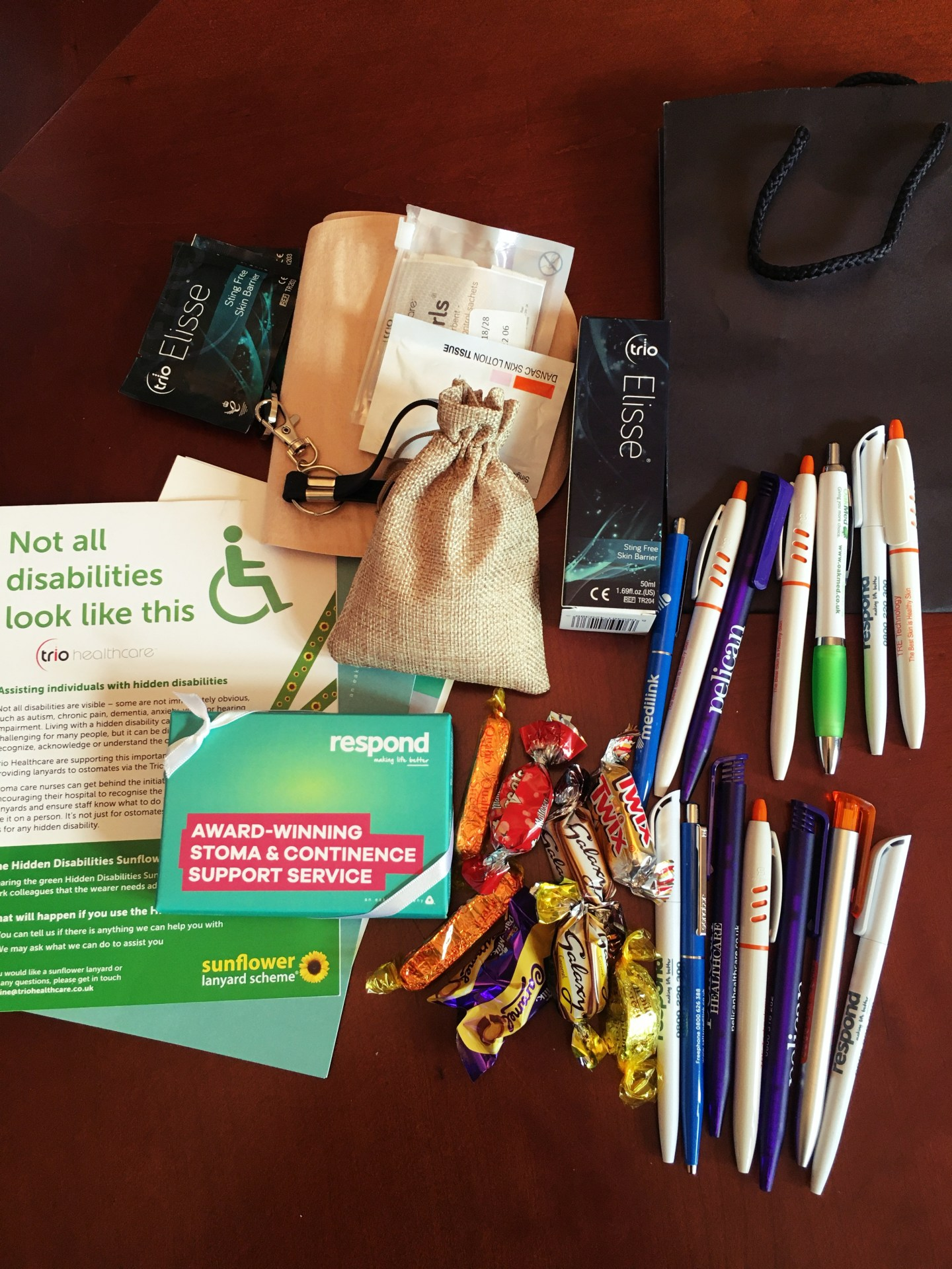 A photo of the freebies I picked up, including stoma samples, sweets and pens.