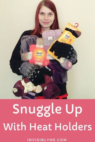 A photo of me holding all the Heat Holders socks and the blanket while wearing thermal gloves. Underneath is the post title.