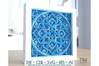 A mandala design in a white box, made as a 3D design with different shades of blue.