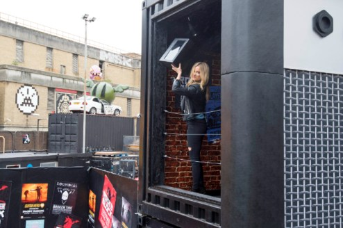 EDITORIAL USE ONLY Television presenter Laura Whitmore celebrates the launch of Guitar Hero Live by recreating the ultimate rock star moment Ð throwing a TV out of a first storey window at LondonÕs Truman Brewery. PRESS ASSOCIATION Photo. Picture date: Thursday October 22, 2015. Guitar Hero Live, available nationwide tomorrow, completely reimagines the pop culture phenomenon, placing you centre stage with live-action gameplay and introduces GHTV, the worldÕs first playable music video network. Photo credit: Matt Crossick/PA Wire