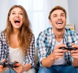 Portrait of happy excited family playing video games