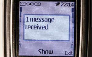 Mobile phone screen image showing 1 message received
