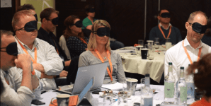 accessibility presentation with audience wearing blindfolds to listen to a screen reader
