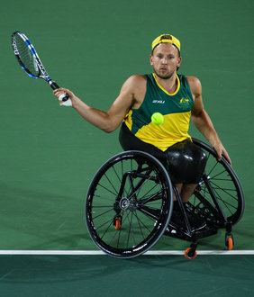 wheelchair quad patio table with umbrella and chairs item ioc photos dylan alcott aus playing against andy lapthorne gbr in the singles gold medal match tennis at olympic centre