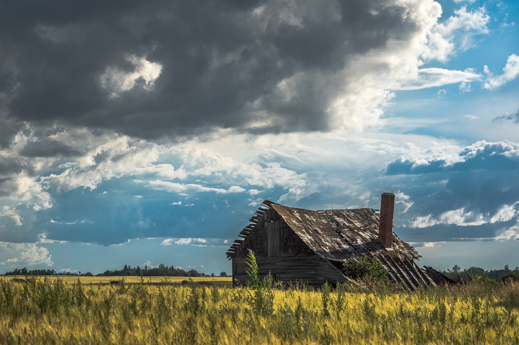 Alberta Homestead with Ominous Skies