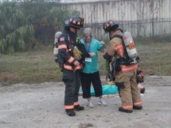 Two Firefighters assisting someone