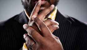 Close up studio portrait of mid adult businessmans hands
