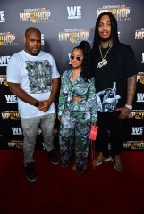 Brandon Barnes pictured with brother Waka Flocka and sister-in-law Tammy Rivera (right)