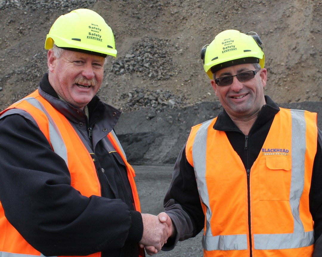 2012 Recipient of the Webster Scholarship, Chris Sinclair, of Wharehine Quarries, is congratulated by President, Gavin Hartley