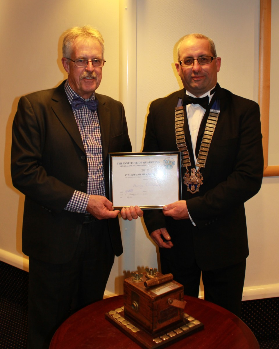 "Gavin Hartley presents <strong>Murray Discombe</strong> with a Certificate for ""Best paper at conference"" and the Lyn Jordan Memorial Trophy"