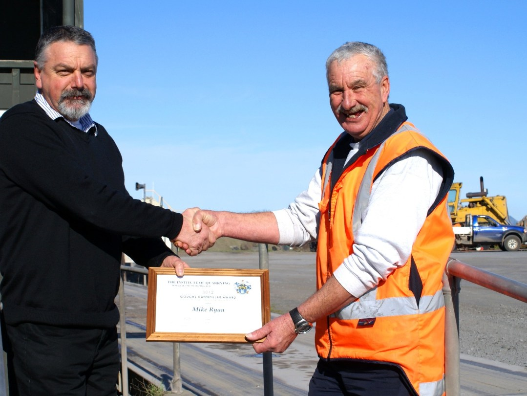 Tony Smith presents <strong> Mike Ryan</strong> Quarry Manager at Ihumatao Quarries with the GoughCAT Travel Award.