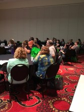 Tables of conferencegoers in a session.