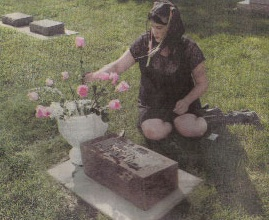 Crystal Haas visits her mother's grave