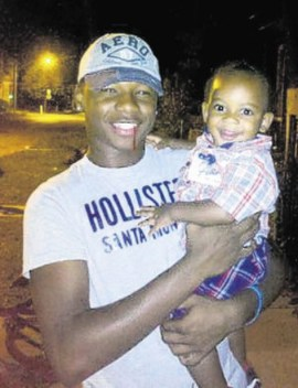 Marlon Barber Jr., 15, with his 1-year-old brother, Shannon. (Courtesy Telegraph-Herald)