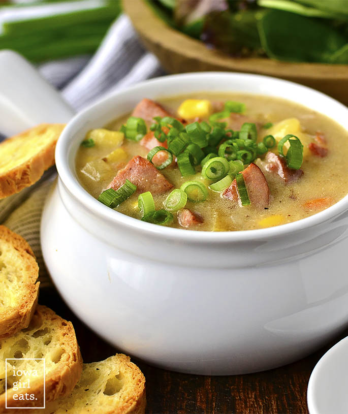 Sweet Corn, Kielbasa and Potato Soup is for the coldest of nights! Thishearty and comforting,gluten-free soup recipe is filled with sweet corn, savory kielbasa and bacon, and creamy potatoes. | iowagirleats.com