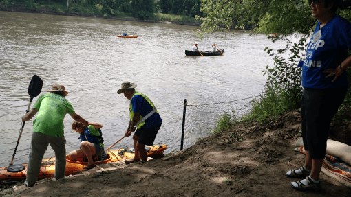 Protesters join the flotilla at the Norton's Ford put-in site. Photo: Gavin Aronsen/Iowa Informer