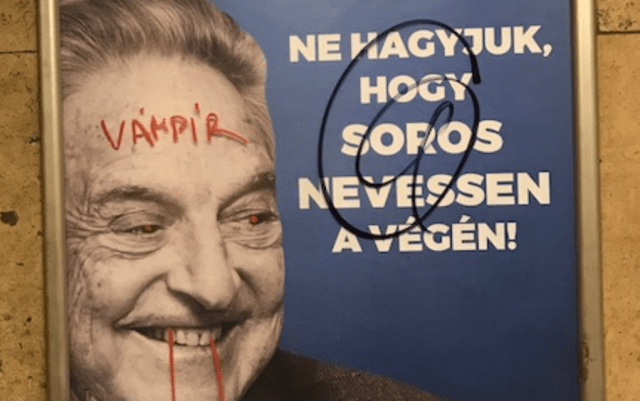 "A vandalized anti-Soros posted with ""Vampire"" written across the Hungarian philanthropist's forehead. Photo: Lydia Gall/Human Rights Watch"