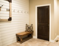 White Baseboard Trim with Dark Wood Door - Iowa Remodels