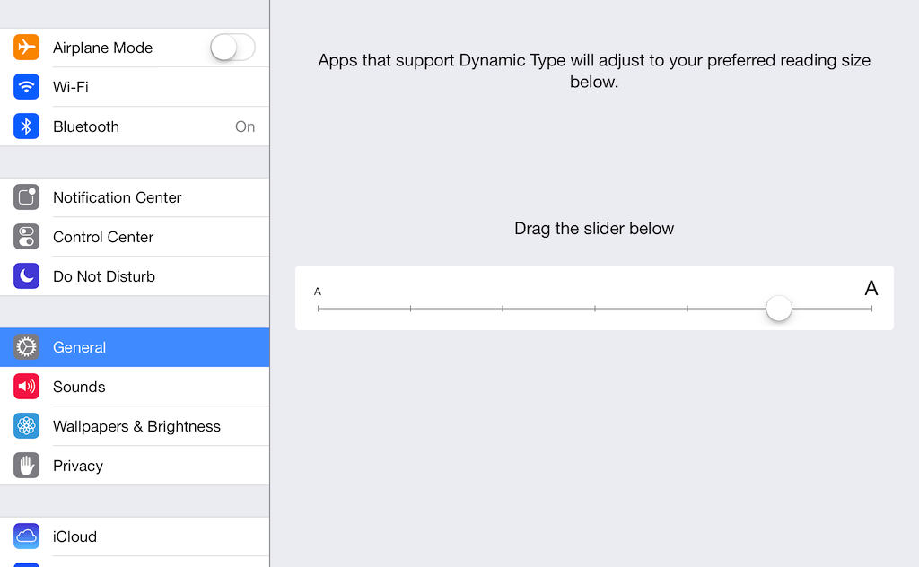 Drag the slider to adjust the text size in iOS 7