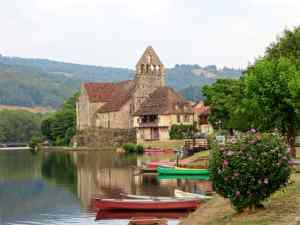 Beaulieu-sur-Dordogne, France, river, church, canoes