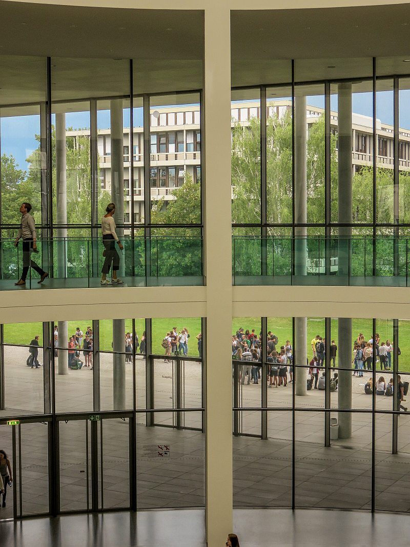 view through glass windows from the second floor of a modern building, Pinakothek der Moderne in Munich Germany