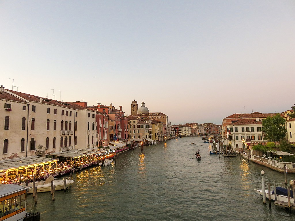 a canal lined up with houses and boats on it at sunset, Canal Grande in Venice at sunset