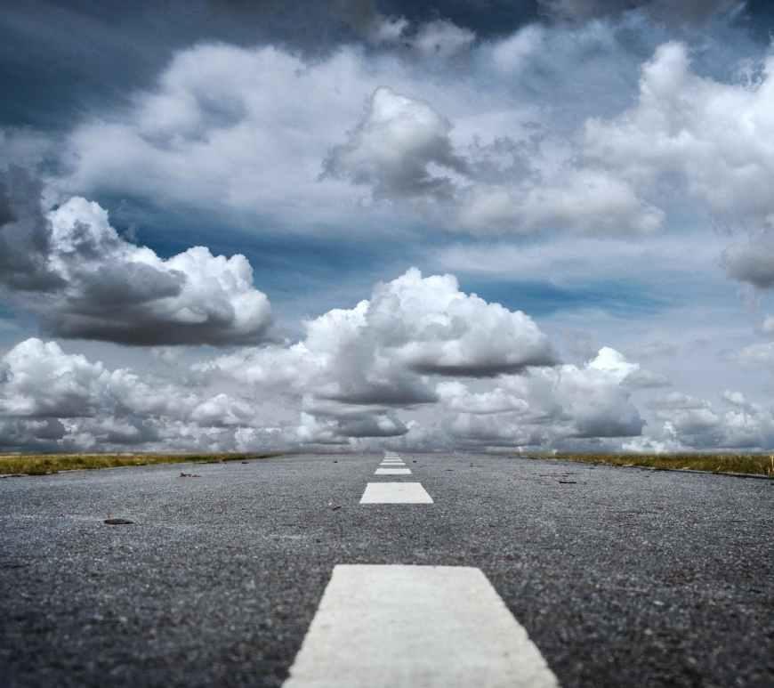 gray rolled asphalt road under cloudy sky