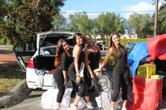 Seniors Daniela Hill, Elena Espinoza, Logan Roberts and Sophia Clayton prepare their cars for Trunk or Treat on behalf of the Patriot Dancers. (Photo/Maia Fernandez Baigun)