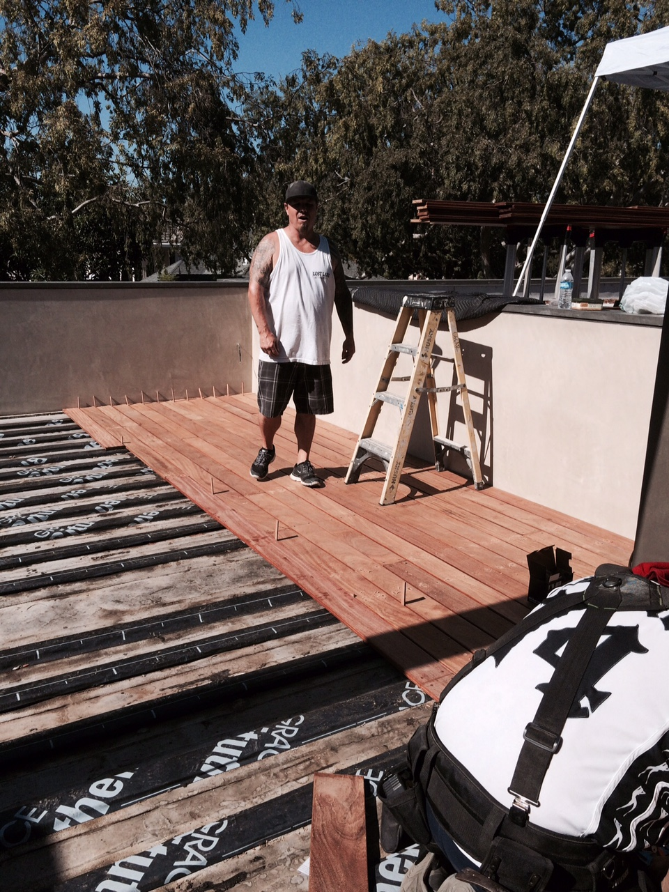 Contractor installation of ipe deck.