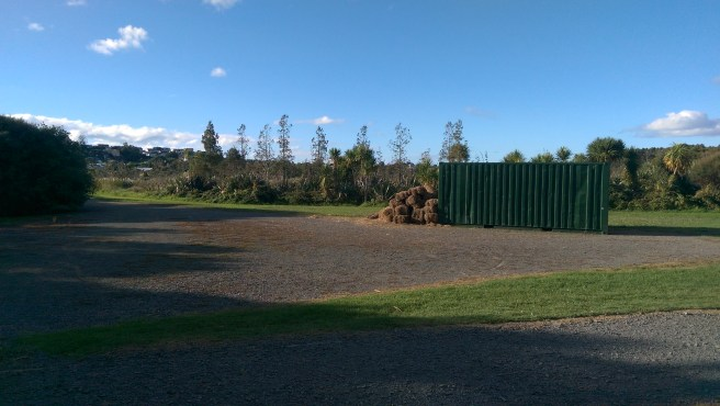 The hay bales and container near the sneaky park entrance