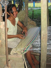 Ging-Ging weaving our bedding. Photo by John Cavanagh